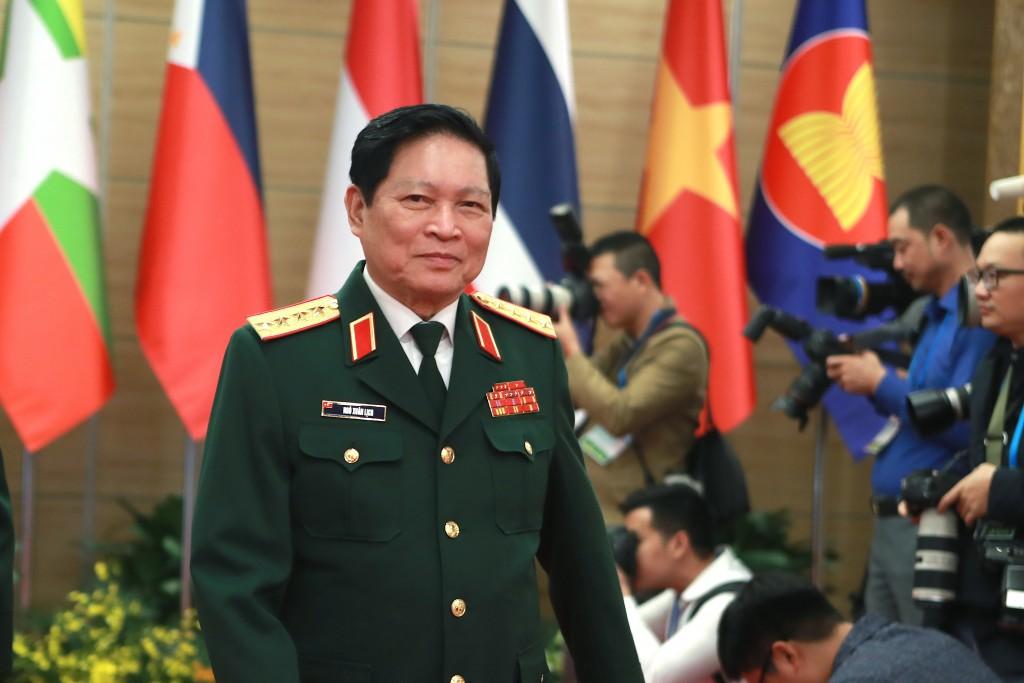 Vietnamese Defense Minister Ngo Xuan Lich arrives at the venue for the online ASEAN Summit in Hanoi, Vietnam on Thursday, Nov. 12, 2020. (AP Photo/Hau...