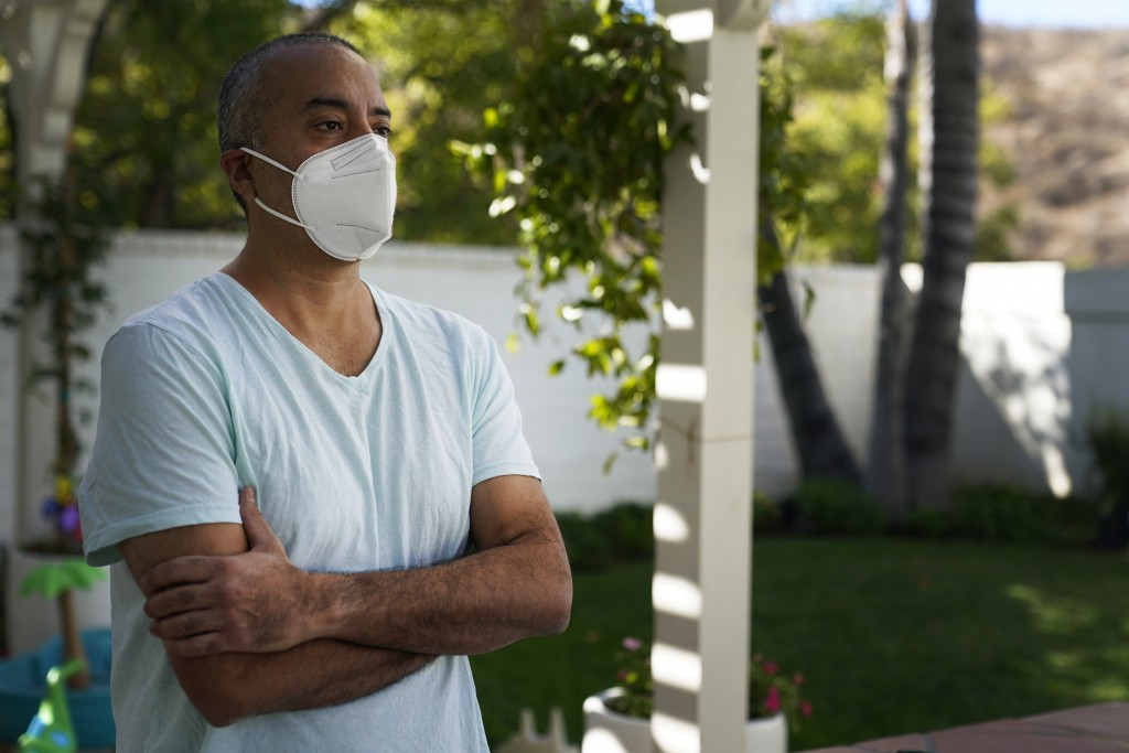 Antonio Gomez poses for a photo at home, Wednesday, Nov. 11, 2020, in Simi Valley, Calif. Gomez is recovering at home after a three-week bout with COV...