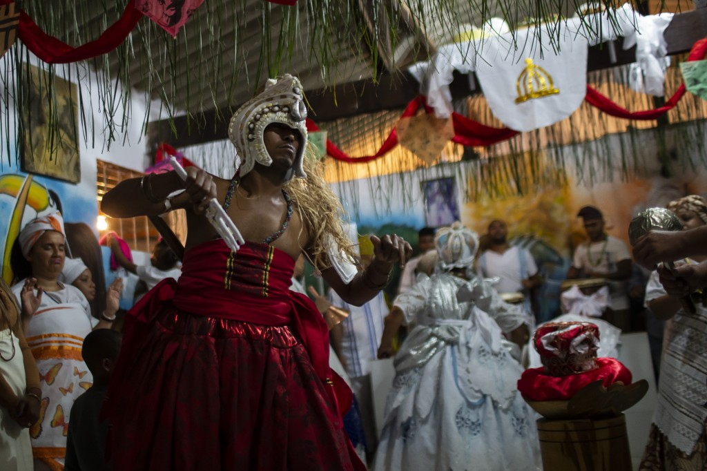 A man in trance dances during a Candomble religious ceremony at the Ile Ase Yoba temple in Seropédica, Rio de Janeiro state, Brazil, Sunday, Oct. 31, ...
