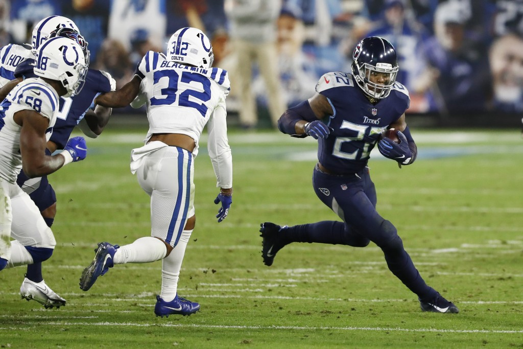 Tennessee Titans running back Derrick Henry (22) carries the ball against Indianapolis Colts free safety Julian Blackmon (32) in the first half of an ...