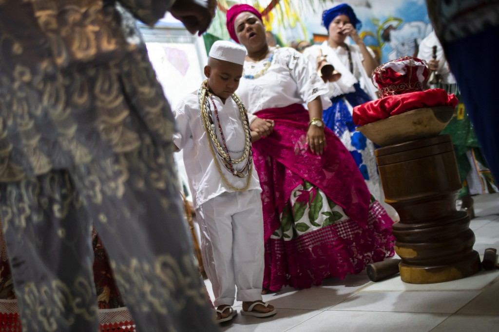 Five-year-old Ricardo Junior de Xango is ordained as an Ogan priest, which is reserved for those chosen by the ancestral deity Orixá for having spirit...