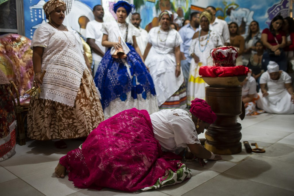 People hold a Candomble religious ceremony at the Ile Ase Yoba temple in Seropedica, Rio de Janeiro state, Brazil, Saturday, Oct. 31, 2020. Incidents ...