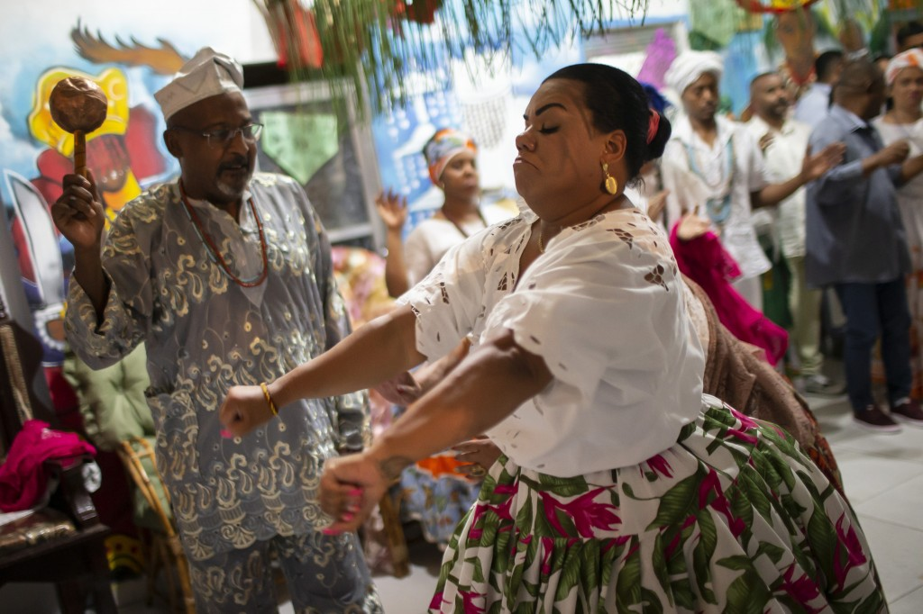 Marcelo Monteiro, left, guides Priestess Yalorixa Lorena Macedo who is in a trance during a religious Candomble ritual at the Ile Ase Yoba temple in S...
