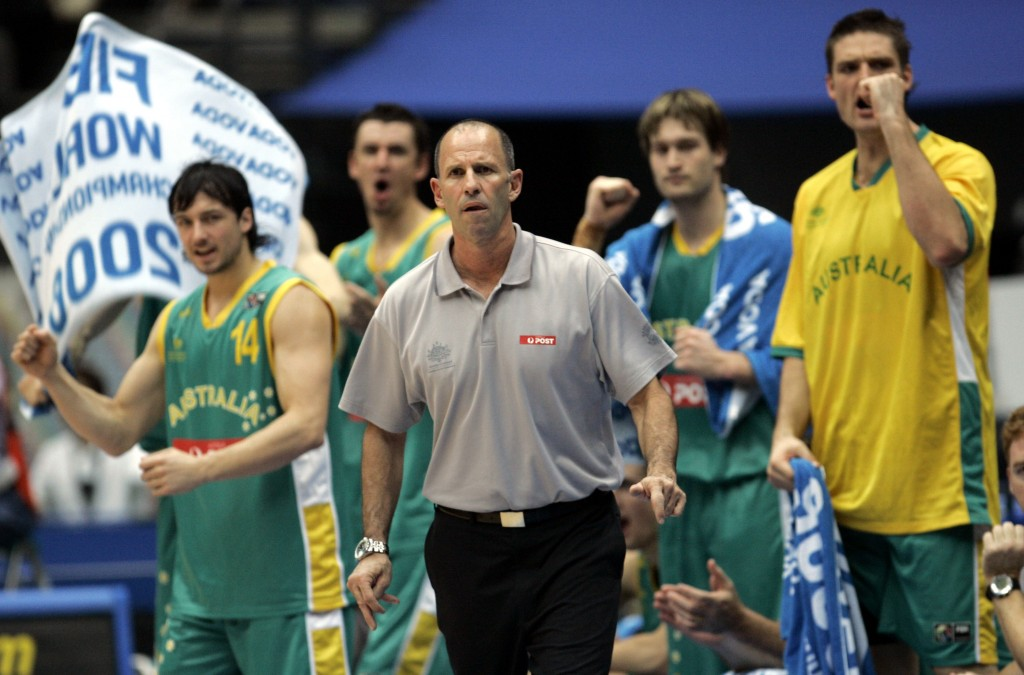 FILE - In this Aug. 27, 2006, file photo, Australia's head coach Brian Goorjian, center, and players watch early action against USA Sunday, Aug. 27, 2...