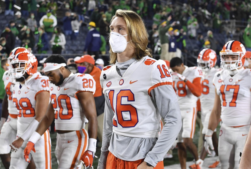 FILE - In this Saturday, Nov. 7, 2020 file photo, Clemson quarterback Trevor Lawrence (16) leaves the field with his teammates after Clemson lost to N...