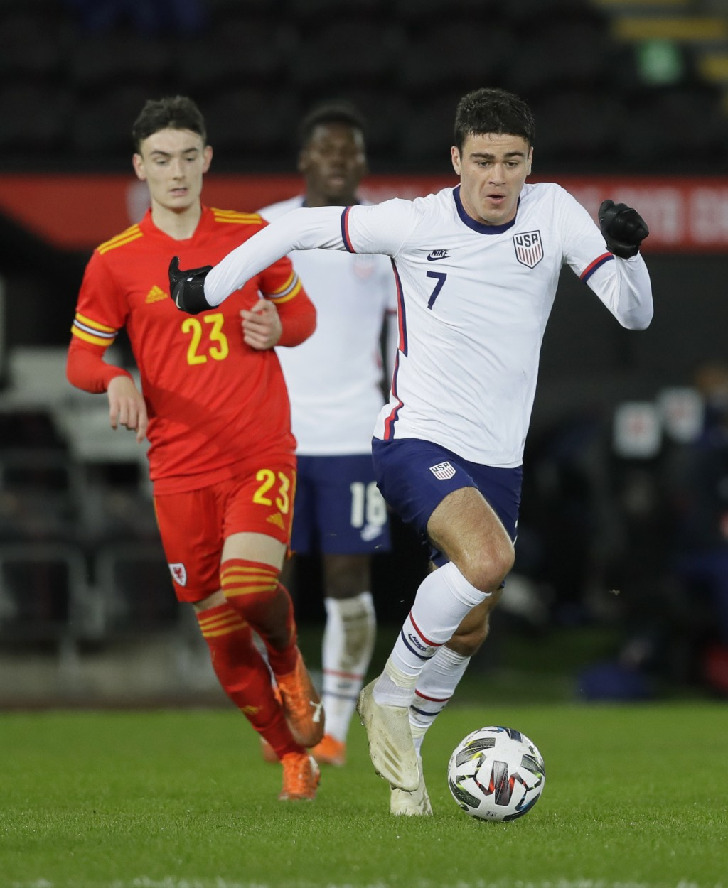 United States' Gio Reyna, right, vies for the ball with Wales' Dylan Levitt during the international friendly soccer match between Wales and USA at Li...