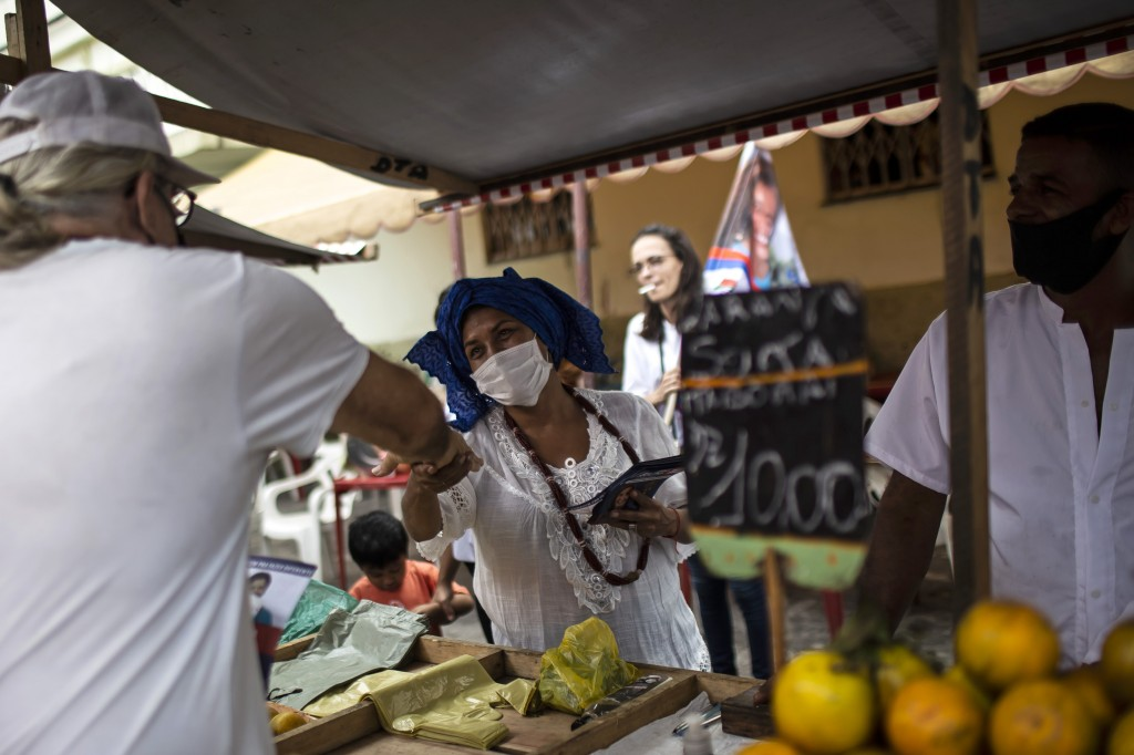 Candomble Priestess Claudia Lima campaigns for a seat on the Rio de Janeiro City Council, representing the PDT-Axé group that derives its name from th...