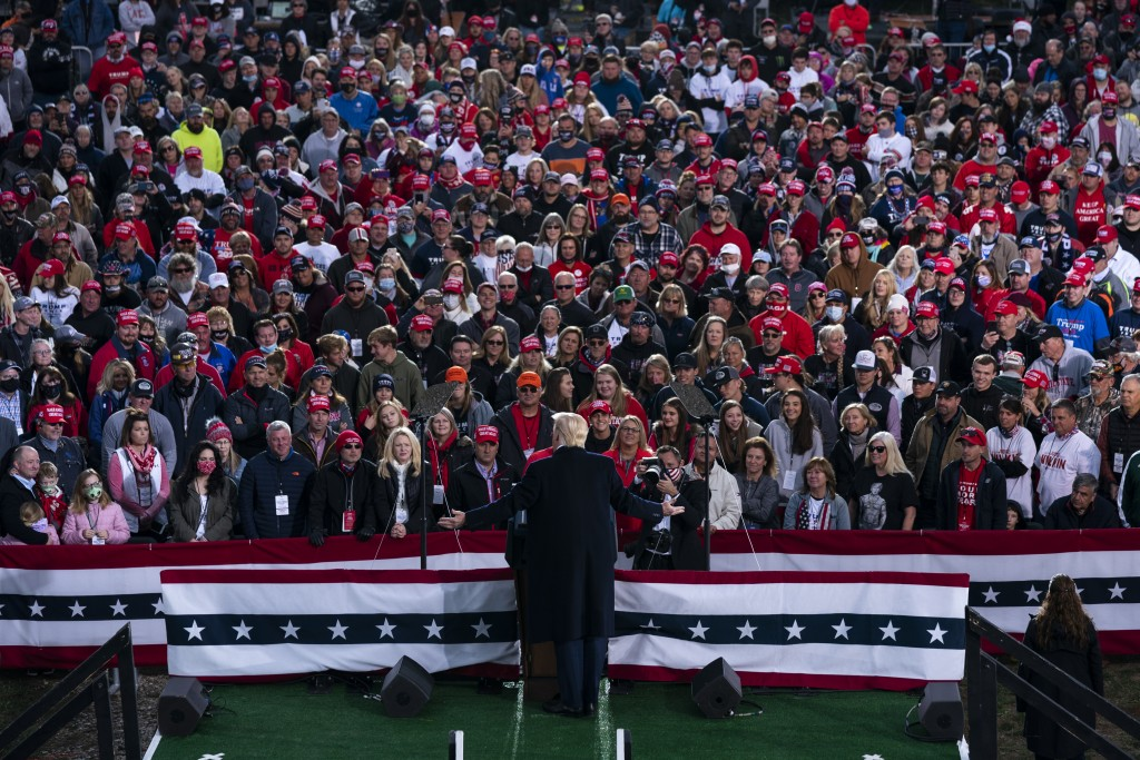 FILE-This Saturday, Oct. 24, 2020 file photo shows President Donald Trump speaking during a campaign rally at Pickaway Agricultural and Event Center, ...