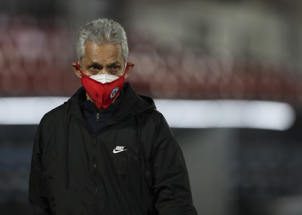 Chile's coach Reinaldo Rueda leaves after the first half during a qualifying soccer match against Peru for the FIFA World Cup Qatar 2022 in Santiago, ...