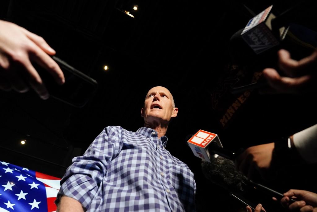 Sen. Rick Scott, R-Fla., speaks to the media after a campaign rally for Republican candidates for U.S. Senate Sen. Kelly Loeffler and Sen. David Perdu...