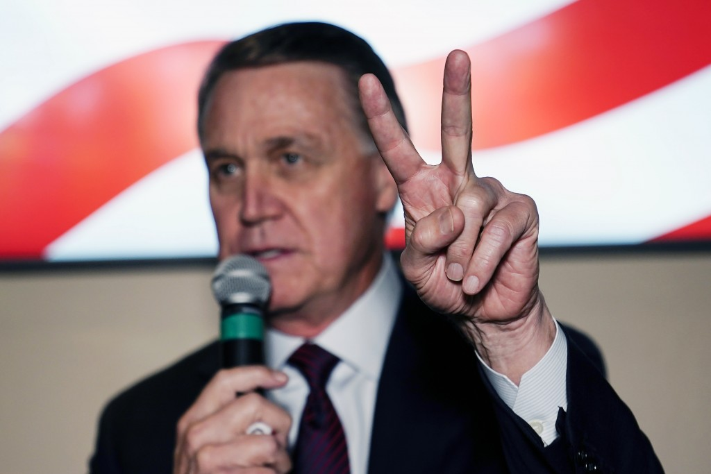 Republican candidate for U.S. Senate Sen. David Perdue speaks during a campaign rally on Friday, Nov. 13, 2020, in Cumming, Ga. Perdue and Democratic ...