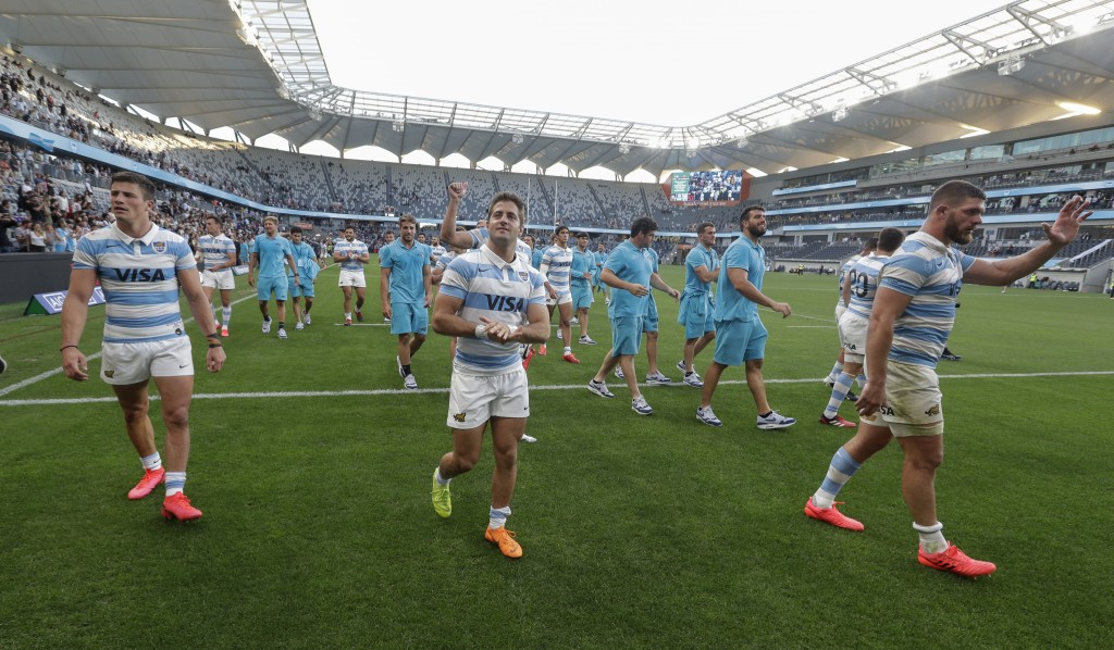 Argentina players wave to the crowd as they celebrate after the Tri-Nations rugby test between Argentina and New Zealand at Bankwest Stadium, Sydney, ...