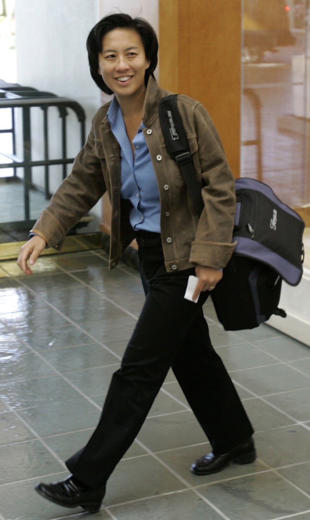 FILE - In this Nov. 5, 2007 file photo,  Los Angeles Dodgers assistant general manager Kim Ng walks through the hotel lobby during the first day of Ma...
