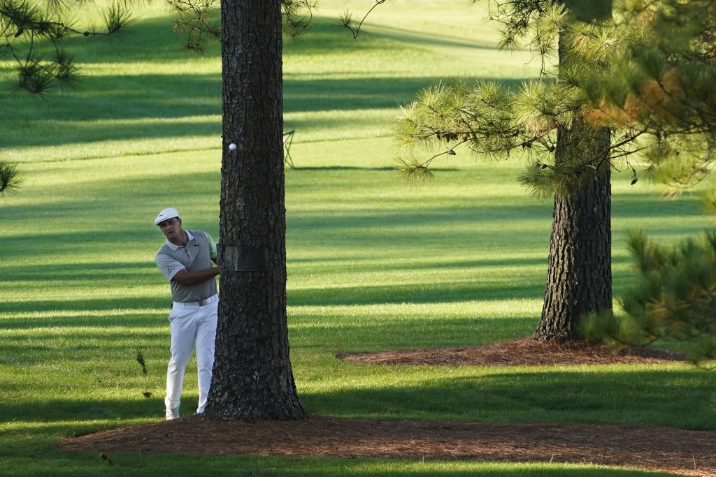 Bryson DeChambeau hits out of the rough on the seventh hole during the second round of the Masters golf tournament Friday, Nov. 13, 2020, in Augusta, ...