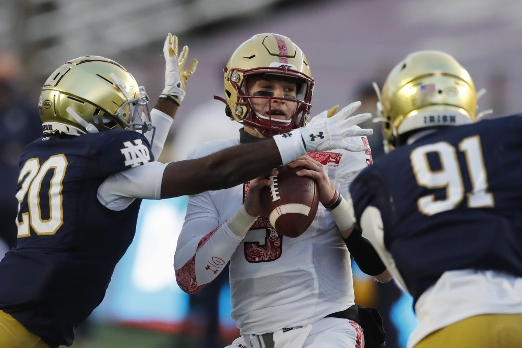 Notre Dame safety Shaun Crawford (20) sacks Boston College quarterback Phil Jurkovec (5) during the first half of an NCAA college football game, Satur...