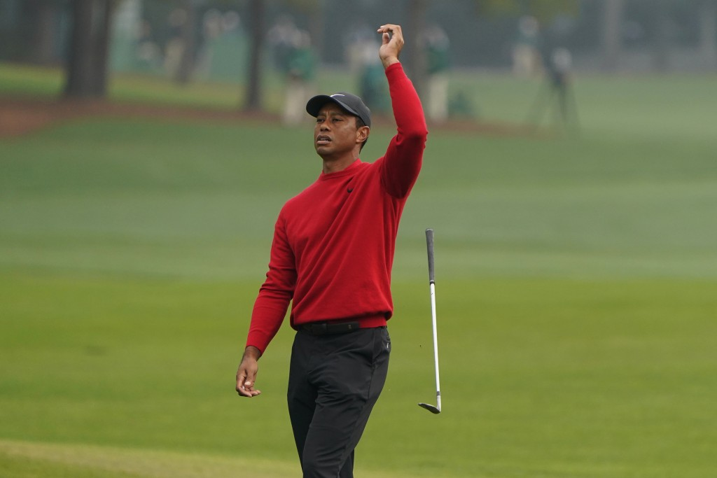 Tiger Woods reacts after a near chip in on the second hole during the final round of the Masters golf tournament Sunday, Nov. 15, 2020, in Augusta, Ga...