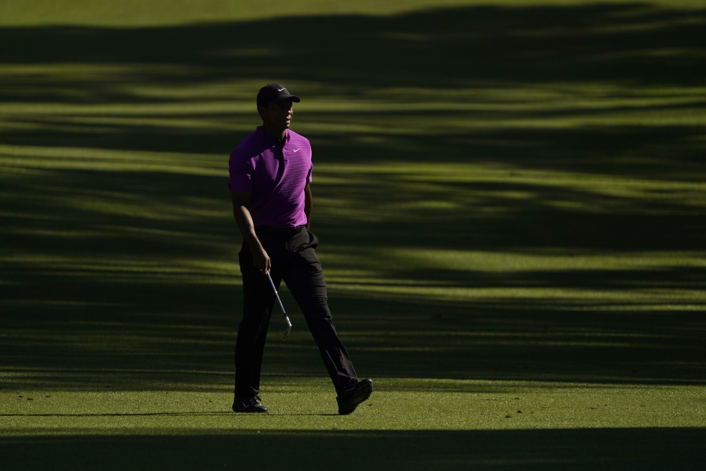 Tiger Woods walks on the 13th fairway during the third round of the Masters golf tournament Saturday, Nov. 14, 2020, in Augusta, Ga. (AP Photo/David J...