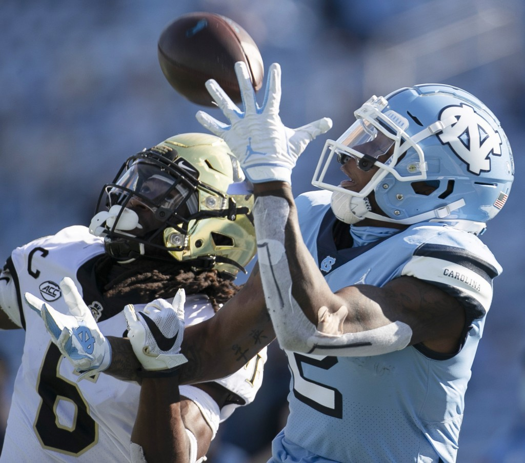 Wake Forest defense back Ja'Sir Taylor (6) defends North Carolina's Dyami Brown (2) in the first half of an NCAA college football game Saturday, Nov. ...