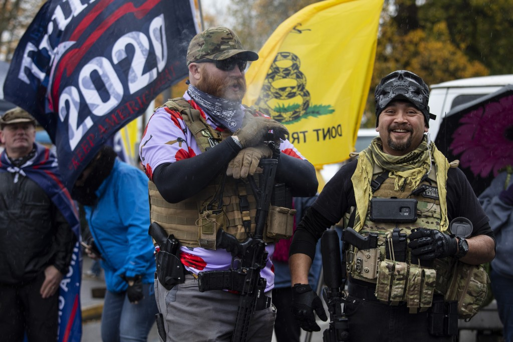 Armed supporters of President Donald Trump attend a ' Stop The Steal ' rally at the Oregon State Capitol protesting the outcome of the election on Sat...