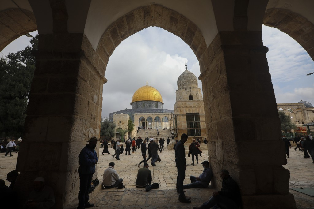 Muslims gather for Friday prayer, next to the Dome of the Rock Mosque in the Al Aqsa Mosque compound in Jerusalem's old city, Friday, Nov. 6, 2020. Th...