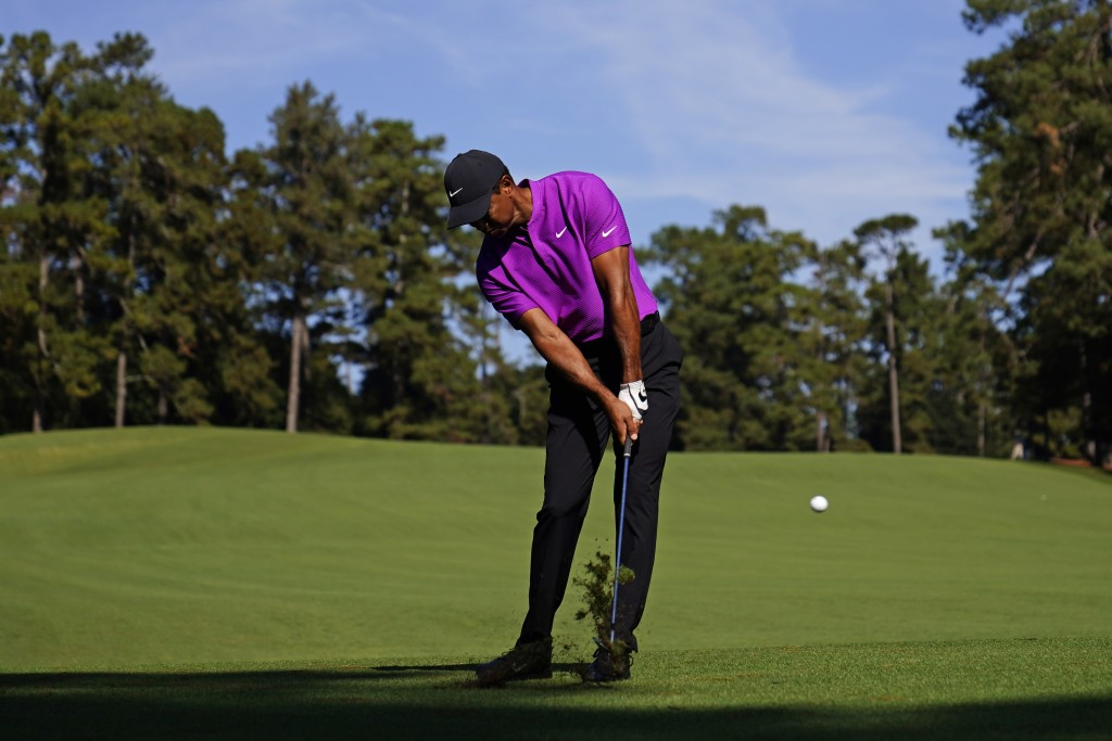 Tiger Woods hits on the second fairway during the third round of the Masters golf tournament Saturday, Nov. 14, 2020, in Augusta, Ga. (AP Photo/Matt S...