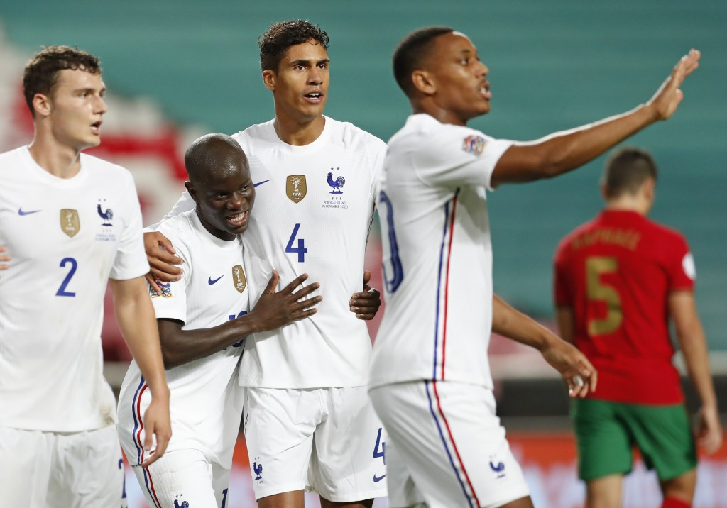 France's N'Golo Kante, second left, celebrates after scoring his side's opening goal during the UEFA Nations League soccer match between Portugal and ...