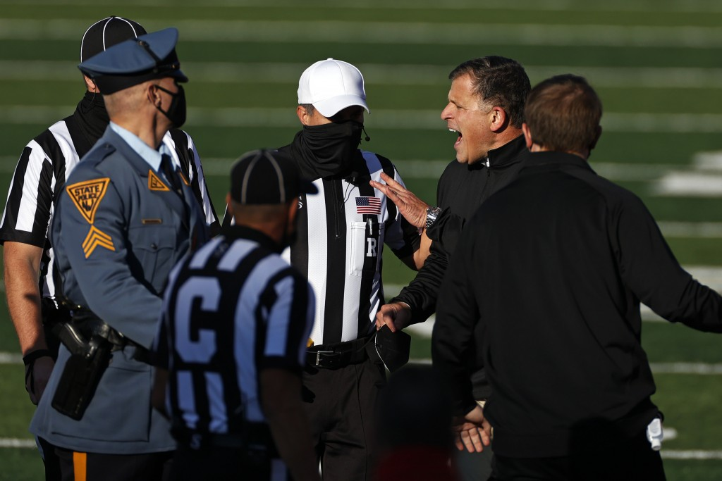 Rutgers head coach Greg Schiano argues with officials at the end of the first half of an NCAA college football game against Illinois on Saturday, Nov....