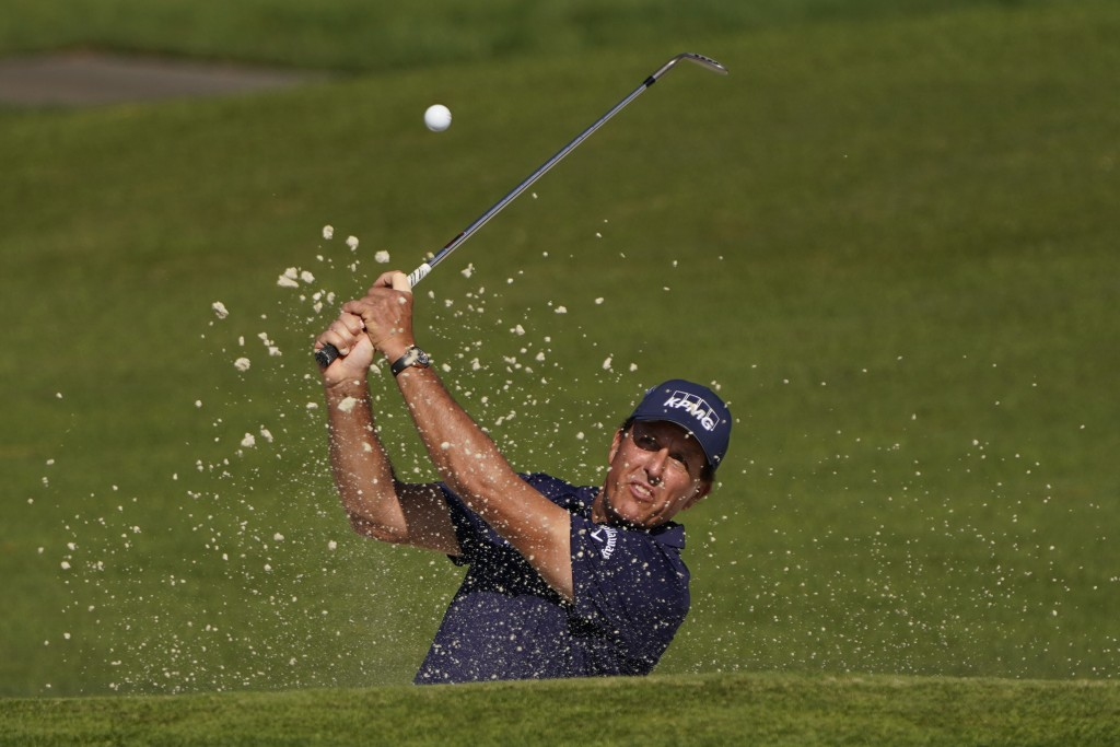 Phil Mickelson chips to the second green during the third round of the Masters golf tournament Saturday, Nov. 14, 2020, in Augusta, Ga. (AP Photo/Chri...