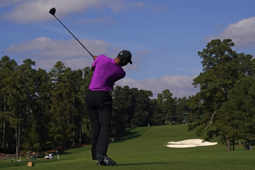 Tiger Woods tees off on the eighth hole during the third round of the Masters golf tournament Saturday, Nov. 14, 2020, in Augusta, Ga. (AP Photo/Chris...