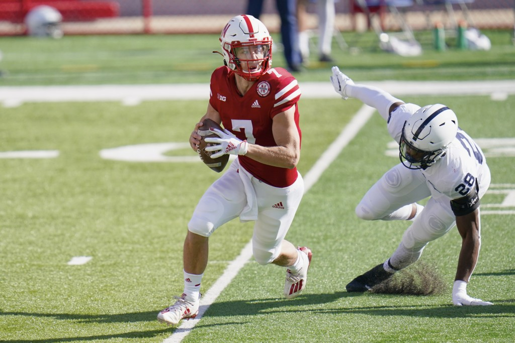 Nebraska quarterback Luke McCaffrey (7) is pursued by Penn State defensive end Jayson Oweh (28) during the first half of an NCAA college football game...