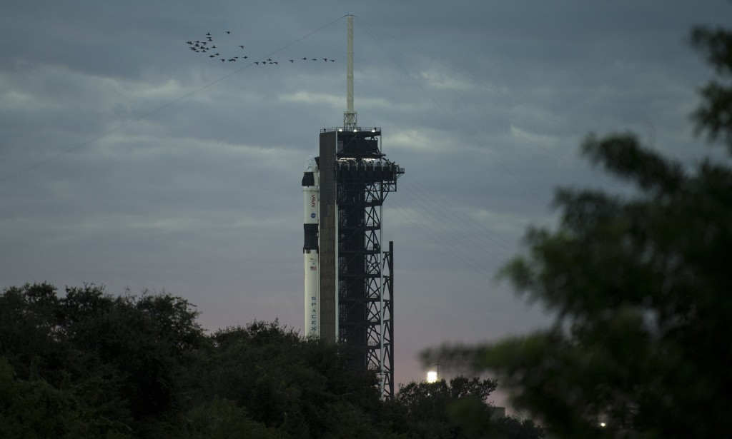 A SpaceX Falcon 9 rocket with the company's Crew Dragon spacecraft onboard is seen on the launch pad at Launch Complex 39A as preparations continue fo...