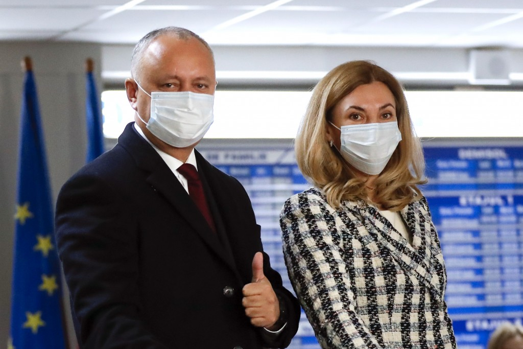 Incumbent Moldovan President Igor Dodon and his wife Galina cast their votes in the country's presidential election runoff in Chisinau, Moldova, Sunda...