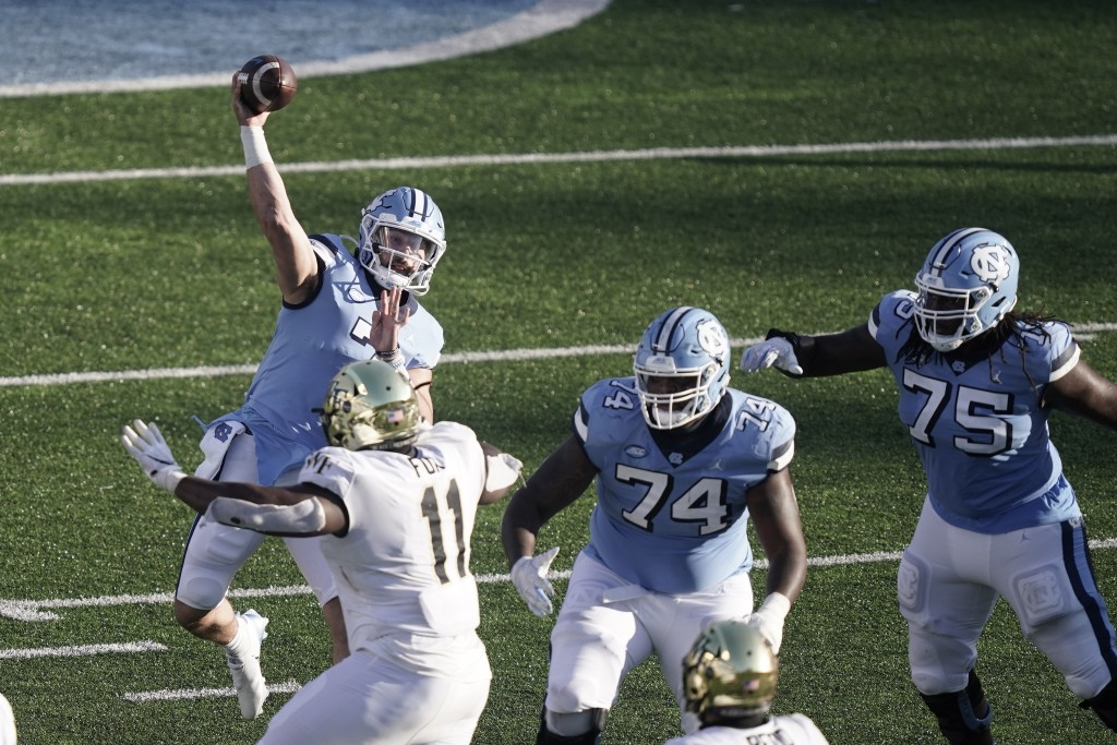 North Carolina quarterback Sam Howell (7) passes against Wake Forest during the second half of an NCAA college football game in Chapel Hill, N.C., Sat...