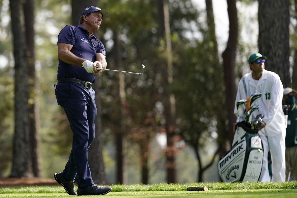 Phil Mickelson watches his drive on the fourth tee during the third round of the Masters golf tournament Saturday, Nov. 14, 2020, in Augusta, Ga. (AP ...