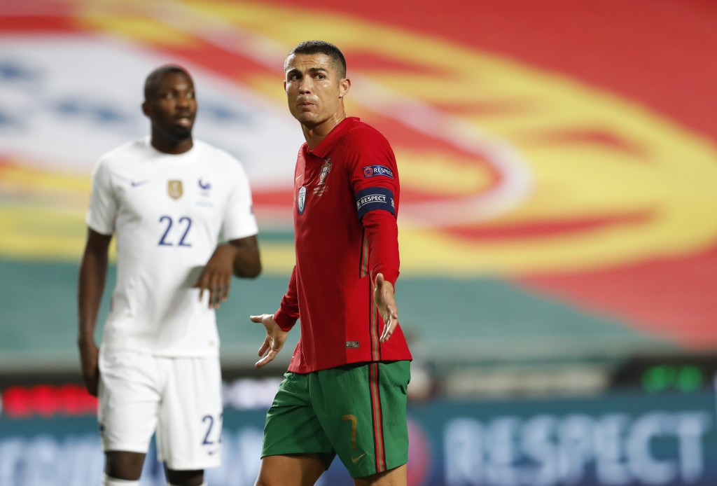 Portugal's Cristiano Ronaldo gestures during the UEFA Nations League soccer match between Portugal and France at the Luz stadium in Lisbon, Saturday, ...