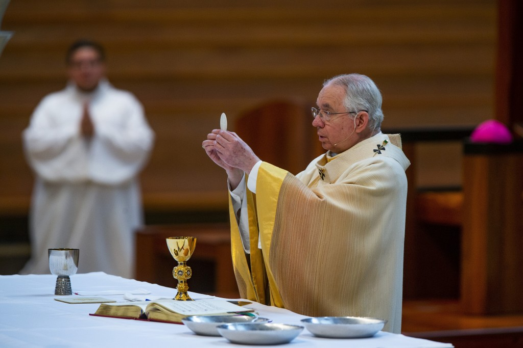 FILE - In this Sunday, June 7, 2020 file photo, Archbishop Jose H. Gomez celebrates the the Solemnity of the Most Holy Trinity Mass at the Cathedral o...