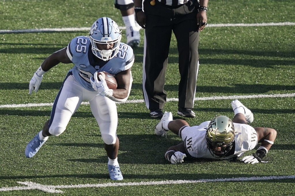 North Carolina running back Javonte Williams (25) finds some running room during the second half of an NCAA college football game against Wake Forest ...