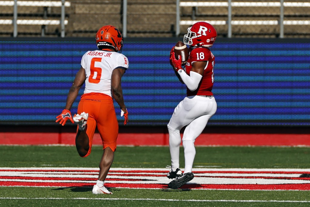 Rutgers wide receiver Bo Melton (18) scores a touchdown in front of Illinois defensive back Tony Adams during the first half of an NCAA college footba...