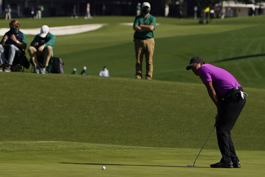 Tiger Woods reacts after missing a birdie putt on the second hole during the third round of the Masters golf tournament Saturday, Nov. 14, 2020, in Au...