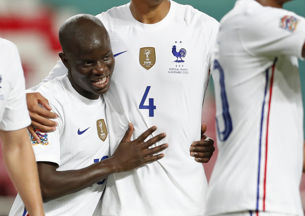 France's N'Golo Kante, left, celebrates after scoring his side's opening goal during the UEFA Nations League soccer match between Portugal and France ...