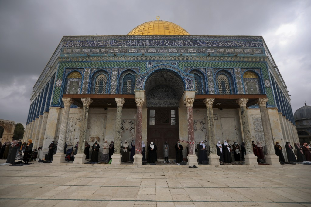 Muslim women gather for Friday prayer, next to the Dome of the Rock Mosque in the Al Aqsa Mosque compound in Jerusalem's old city, Friday, Nov. 6, 202...