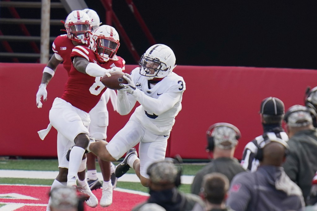 Penn State wide receiver Parker Washington (3) makes a catch against Nebraska safety Deontai Williams (8) during the second half of an NCAA college fo...