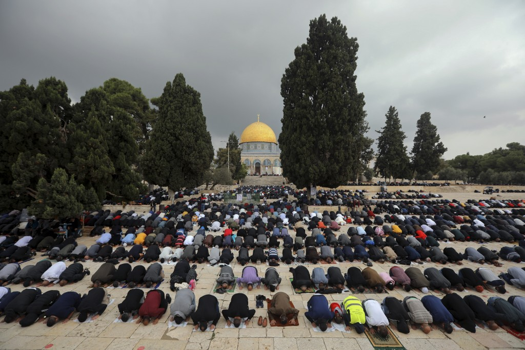 Muslim men pray during Friday prayer, next to the Dome of the Rock Mosque in the Al Aqsa Mosque compound in Jerusalem's old city, Friday, Nov. 6, 2020...