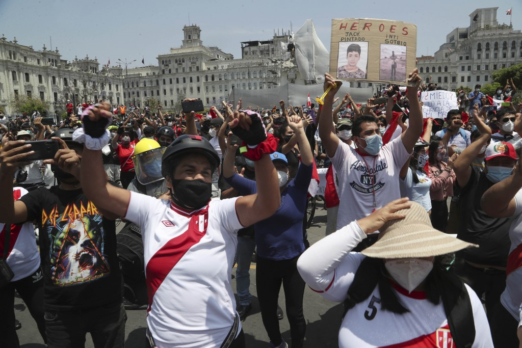 People celebrate after the resignation of interim president Manuel Merino, at Plaza San Martin in Lima, Peru, Sunday, Nov. 15, 2020. Merino resigned a...