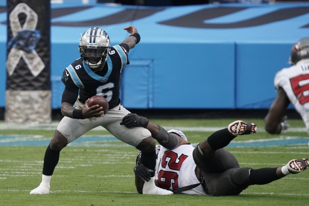 Carolina Panthers quarterback P.J. Walker (6) worlks as Tampa Bay Buccaneers defensive end William Gholston (92) defends during the second half of an ...
