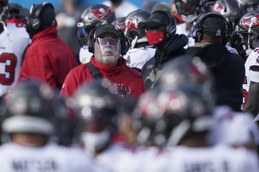 Tampa Bay Buccaneers head coach Bruce Arians walks the sidelines during the first half of an NFL football game against the Carolina Panthers, Sunday, ...