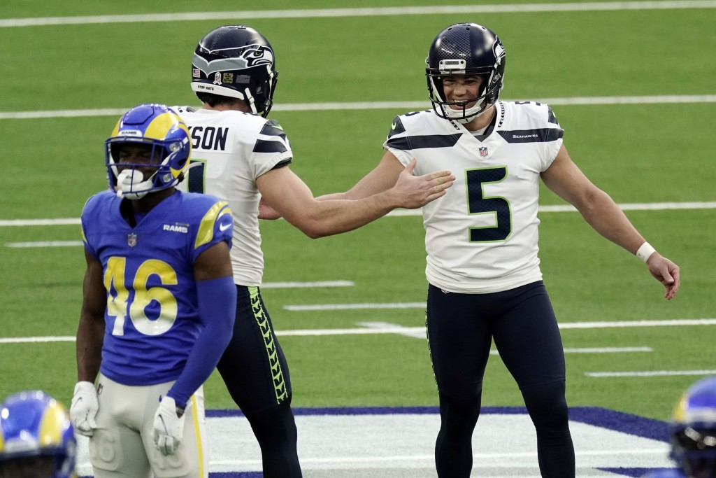 Seattle Seahawks kicker Jason Myers (5) celebrates after making a 61-yard field goal during the second half of an NFL football game against the Los An...