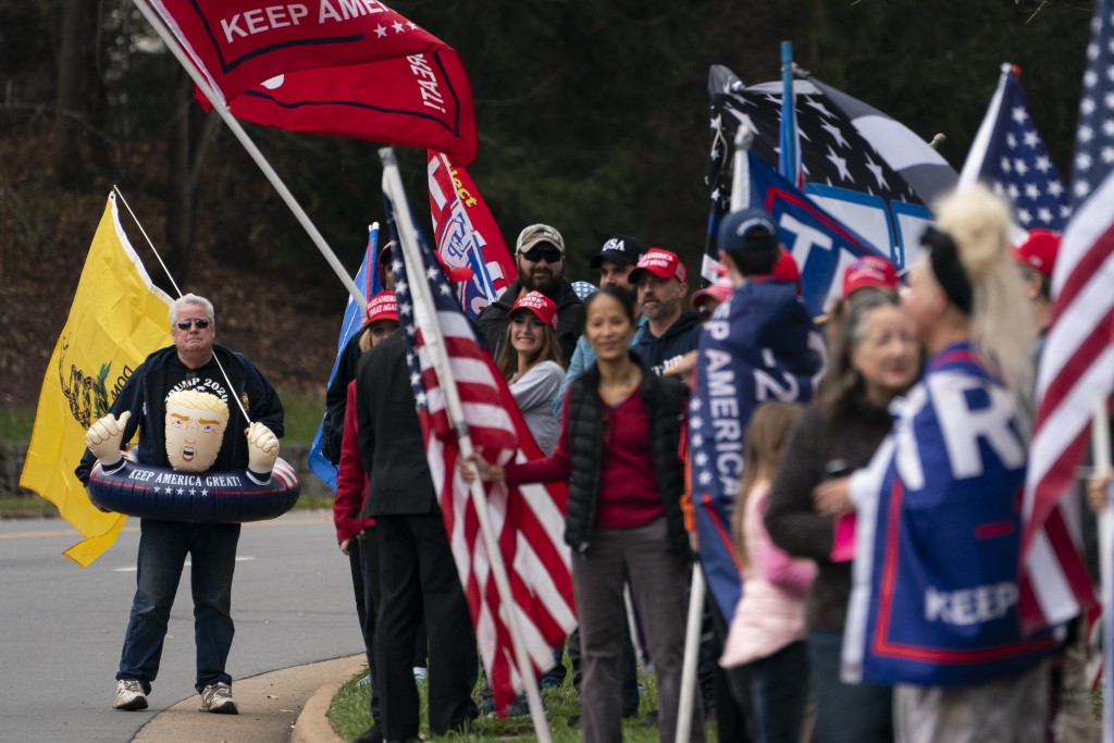 Supporters of President Donald Trump wait for him to depart Trump National Golf Club, Sunday, Nov. 15, 2020, in Sterling, Va. (AP Photo/Evan Vucci)