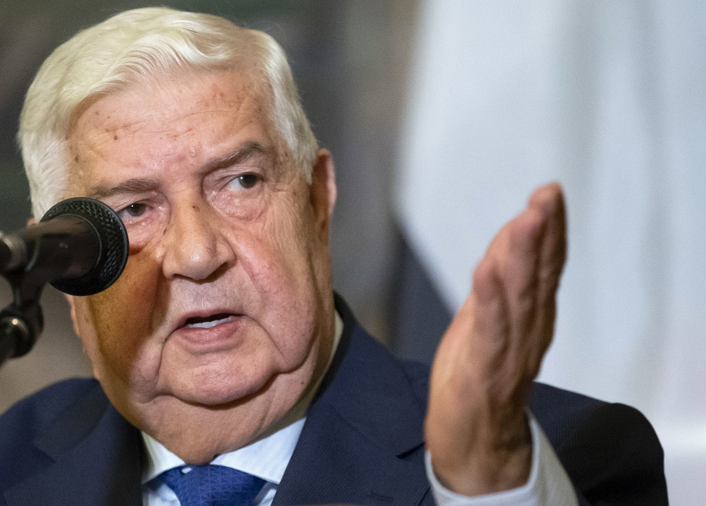 FILE - In this Aug. 30, 2018, file photo, Syrian Foreign Minister Walid al-Moallem gestures as he speaks to the media in Moscow, Russia. Al-Moallem, a...