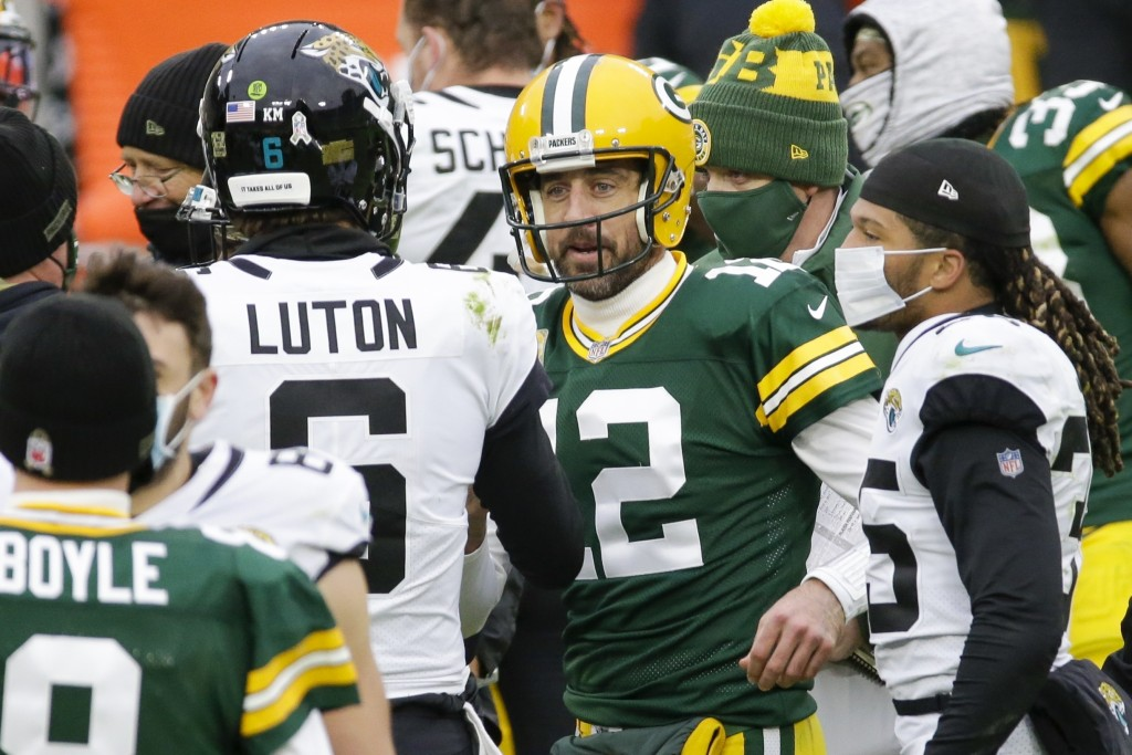 Green Bay Packers' Aaron Rodgers talks to Jacksonville Jaguars' Jake Luton after an NFL football game Sunday, Nov. 15, 2020, in Green Bay, Wis. The Pa...